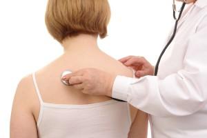 Doktor vyšetřuje pacientku. Gynekologie, Kutná Hora